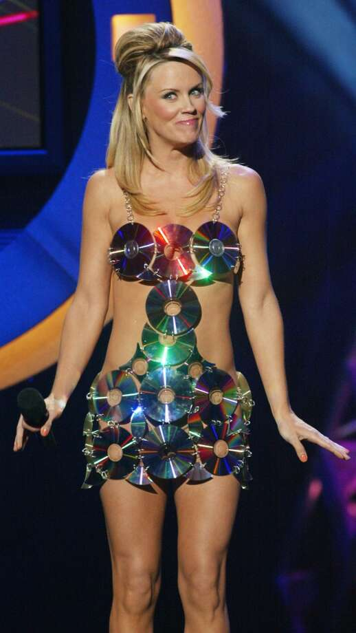 Jenny McCarthy wears a dress made out of DVD's on stage at The 3rd Annual DVD Exclusive Awards held on December 2, 2003. Photo: Kevin Winter, Getty Images