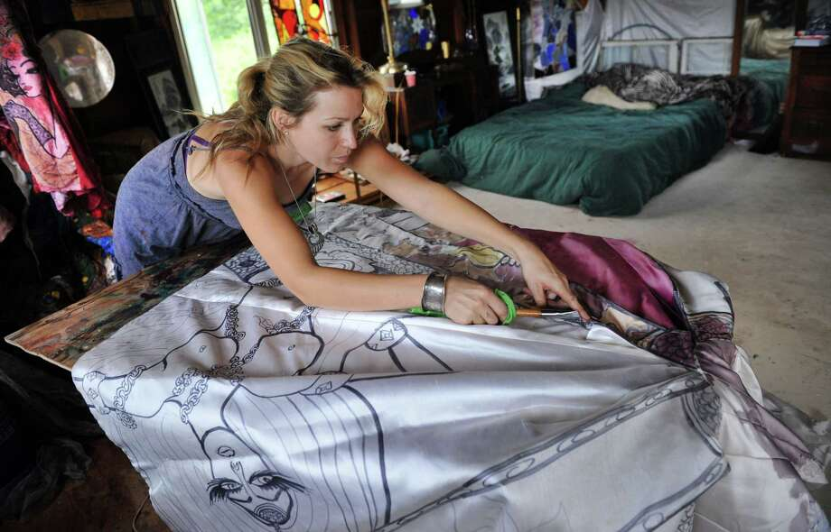 Abigail Vona of New Milford, Conn., paints on a wedding dress in her studio Friday, July 12, 2013. Photo: Carol Kaliff / The News-Times