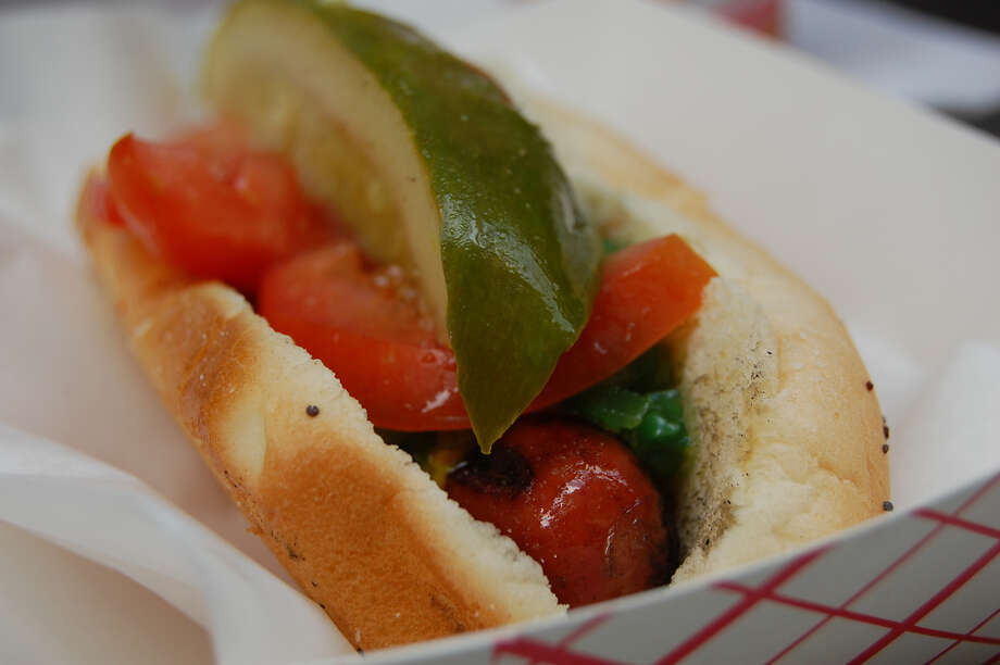 In Chicago, the city's namesake dog comes with yellow mustard, relish, sliced tomatoes, a pickle wedge and celery salt — among other possible toppings. Photo: stu_spivack, Flickr.com