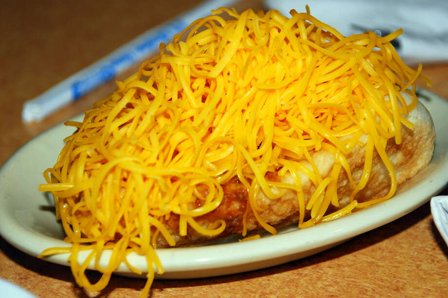 "Cincinnati chili is a con carne chili usually served over spaghetti with cheese, but the ""Cincinnati chili dog"" skips the pasta and goes heavy on the cheese. Photo: Photo_Tourist, Flickr.com"