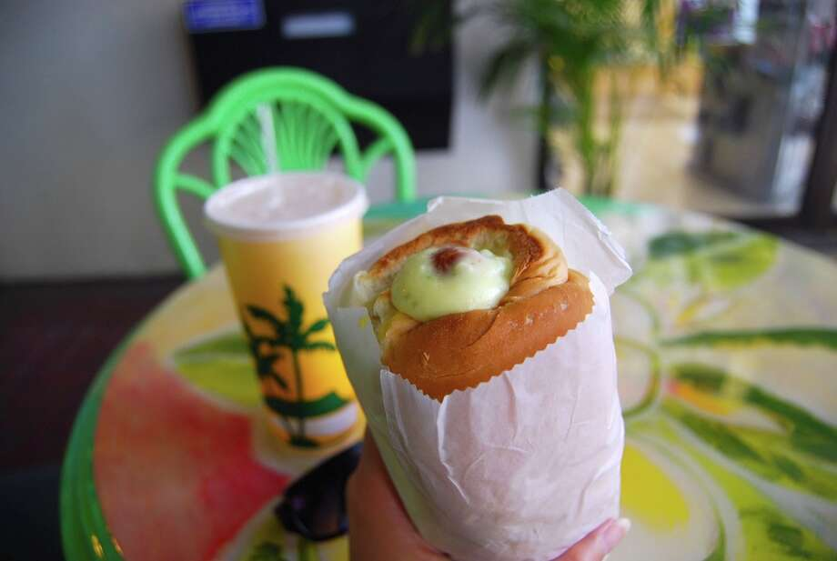 "The ""Puka dog"" is a Hawaiian-style hot dog that is encased in tubular bun and injected with often-sweet and tropically-flavored sauces. Photo: nemuneko.jc, Flickr.com"