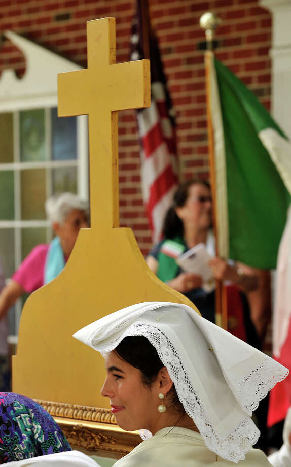 Silvana Cardona poses for photos after the Minturnese community's tenth annual Sagra delle Regne, or harvest festival, procession in front of Sacred Heart Church in Stamford on Sunday, July 14, 2013. The Stamford festival is celebrated simultaneously with its sister city of Minturno, Italy, Photo: Jason Rearick / Stamford Advocate