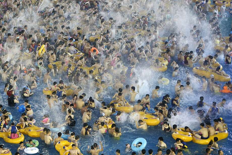 Nightmare for lifeguards: Capacity at a water park in Wuhan, China, is when you can no longer see the water. Photo: Associated Press