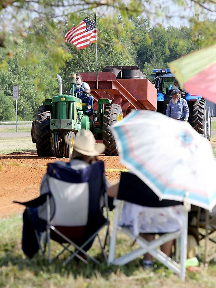 Dan's kind of an antique himself: Tractor pull fans watch in suspense as Dan Longnecker 