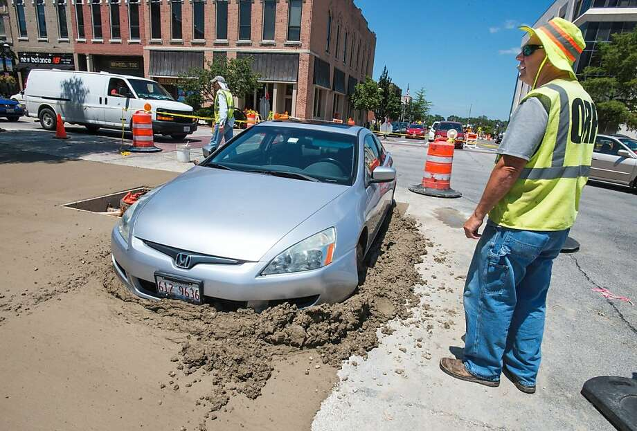 OK if I park here? Doug Fitton of Open Road Paving was just about done laying concrete at the corner of Main and 