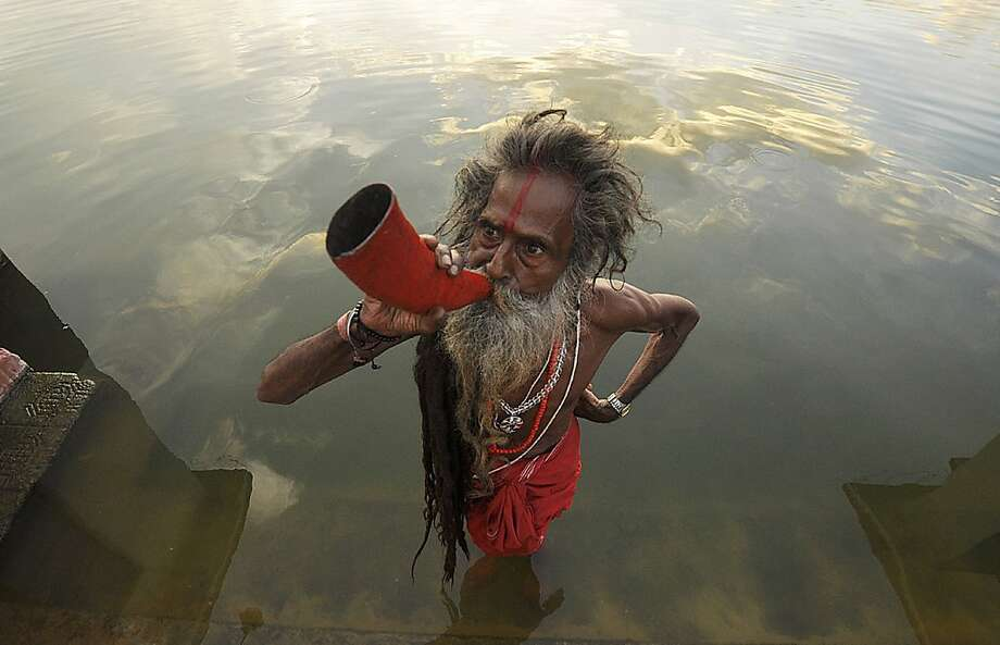 Trumpeting in Tripura:A Hindu sadhu blows a buffalo horn on the eve of the traditional Kharchi Puja festival at Agartala, India's Tripura state. Photo: Arindam Dey, AFP/Getty Images