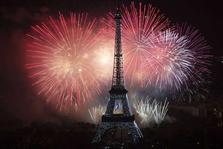 That's an eyeful: Fireworks burst around the Eiffel Tower in Paris on Bastille Day. Photo: Fred Dufour, AFP/Getty Images