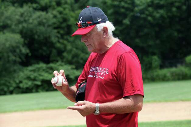 Phil Niekro shows how he grips his knuckleball  - <%=term%>