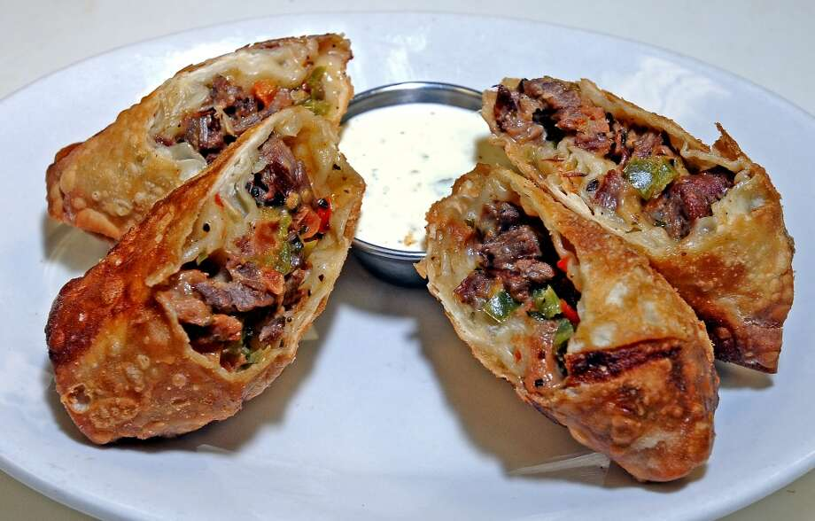The Fajita Eggrolls at Madison's consist of tender beef fajita, grilled bell peppers, pico de gallo, and queso fresco with cilantro ranch.  Photo taken: Randy Edwards/The Enterprise