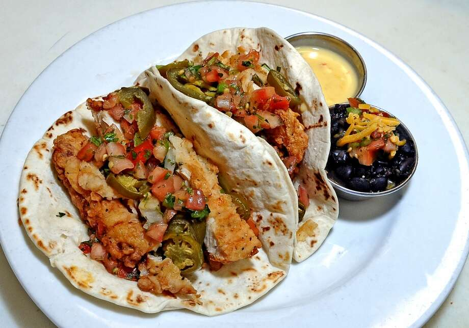 The Texas Taco's at Madison's consist of hot slices of chicken fried steak or chicken wrapped in warm flour tortillas with queso, jalapenos and pico de gallo. Served with your choice of side. Photo taken: Randy Edwards/The Enterprise