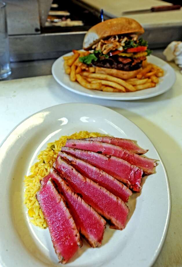 The Ahi Tuna Steak at Madison's consist of a seared Ahi tuna steak over house specialty rice with your choice of side.  Photo taken: Randy Edwards/The Enterprise
