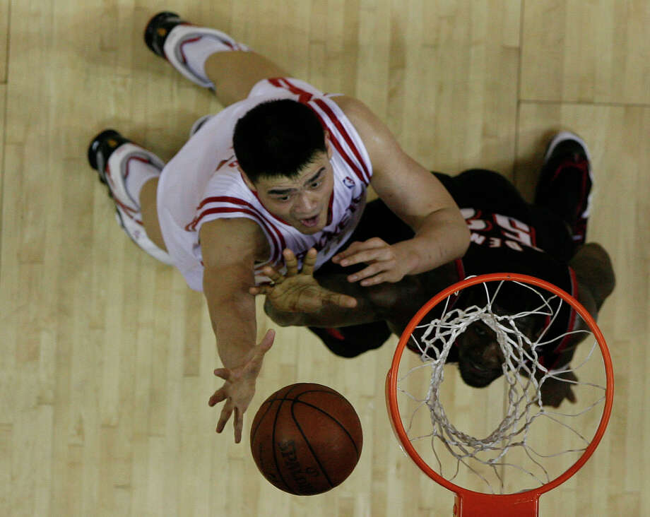 11 - Yao Ming Yao, the No. 1 overall pick in 2002, was an All-Star in each of his eight seasons before a string of injuries forced the 7-6 center into retirement. He finished sixth in franchise history in scoring and rebounding and became an icon in his native China. Photo: James Nielsen, Houston Chronicle / Houston Chronicle