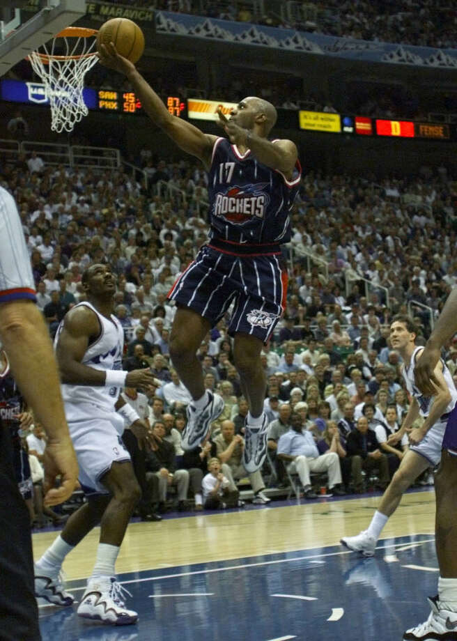 17 - Mario Elie Elie played five seasons in Houston and was a key contributor on the two NBA title teams. He averaged more than 11 points in each of his final two seasons in town. He's best remembered for the Kiss of Death 3-pointer that eliminated the Suns in the 1995 playoffs. Photo: Howard Castleberry, Houston Chronicle / Houston Chronicle