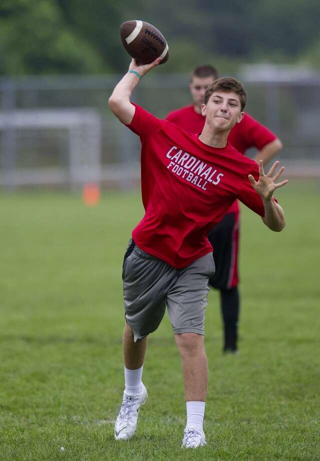 "Greenwich's Matt Marzulla throws a pass during Saturday's ""Grip It and Rip It"" high school football passing camp and competition at New Canaan High School on July 13, 2013."