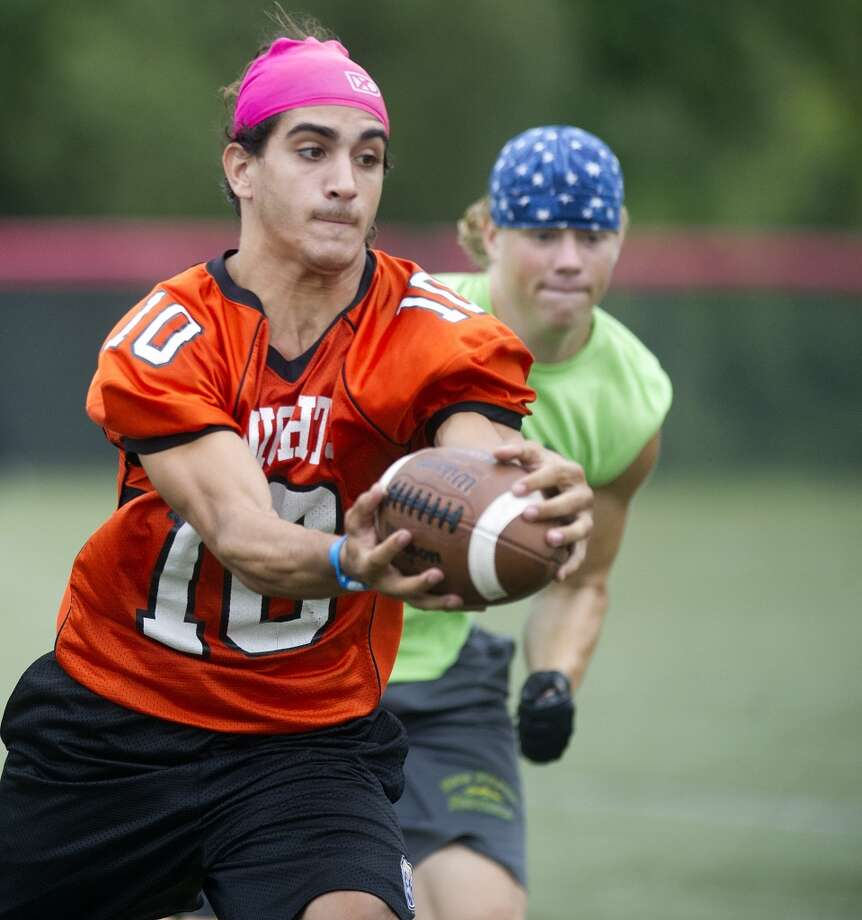 "Stamford's Jake Bivona makes a catch during Saturday's ""Grip It and Rip It"" high school football passing camp and competition at New Canaan High School on July 13, 2013."