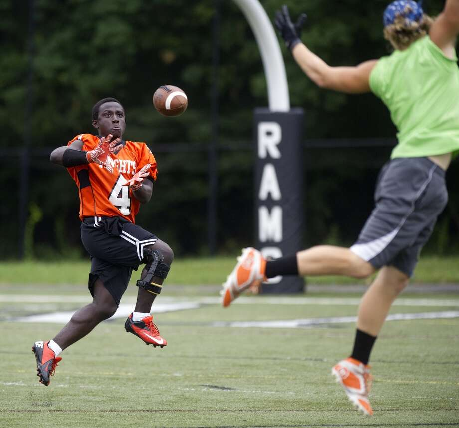 "Stamford's Jerry Aime makes a catch during Saturday's ""Grip It and Rip It"" high school football passing camp and competition at New Canaan High School on July 13, 2013."