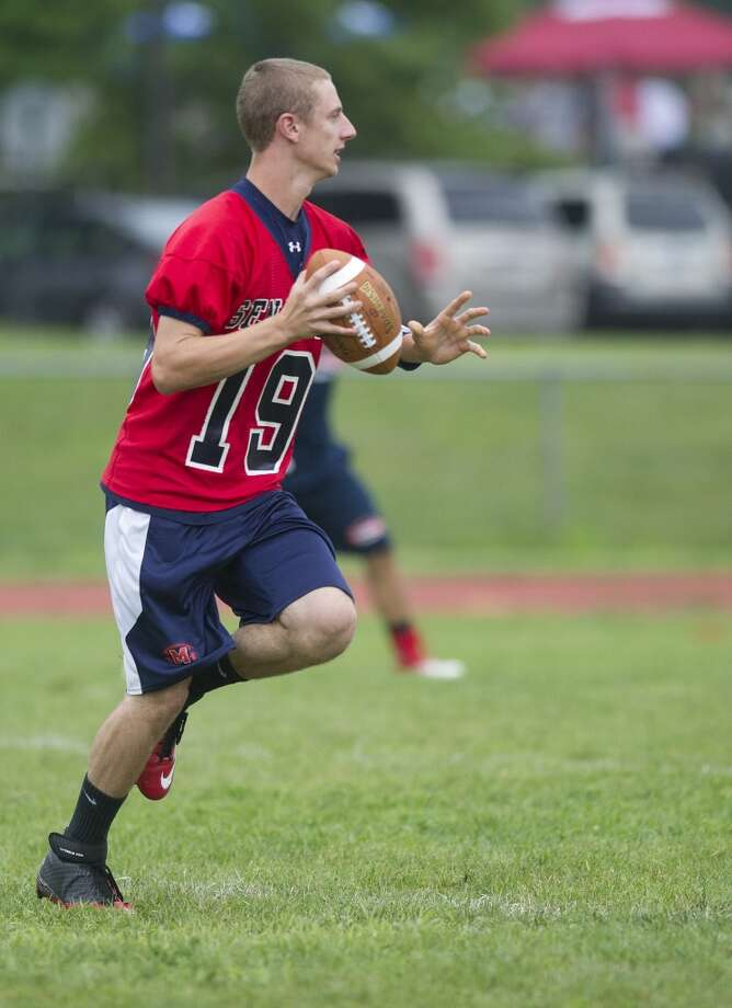 """Brien McMahon's Matt Downey throws a pass during Saturday's """"Grip It and Rip It"""" high school football passing camp and competition at New Canaan High School on July 13, 2013."""