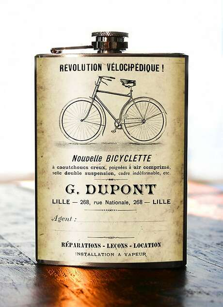 Trixie and Milo's Bicyclette flask is covered in an early 1900s advertisement found in a Paris flea market and reprinted on aged parchment. $29. Photo: Trixie And Milo