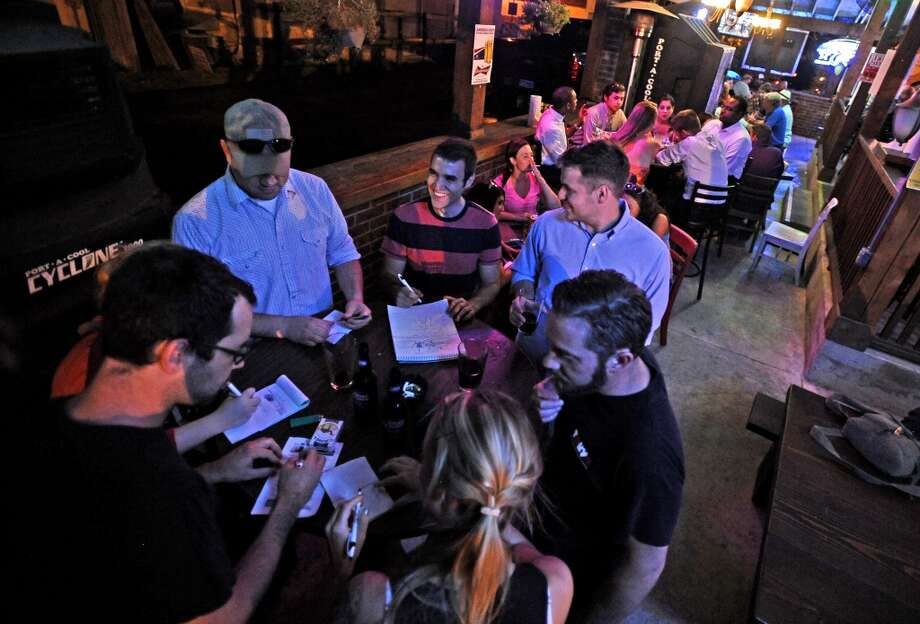 The patio fills up quickly to play Geeks Who Drink trivia game on Tuesday, July 2, 2013, at Luke's. Photo taken: Randy Edwards/The Enterprise