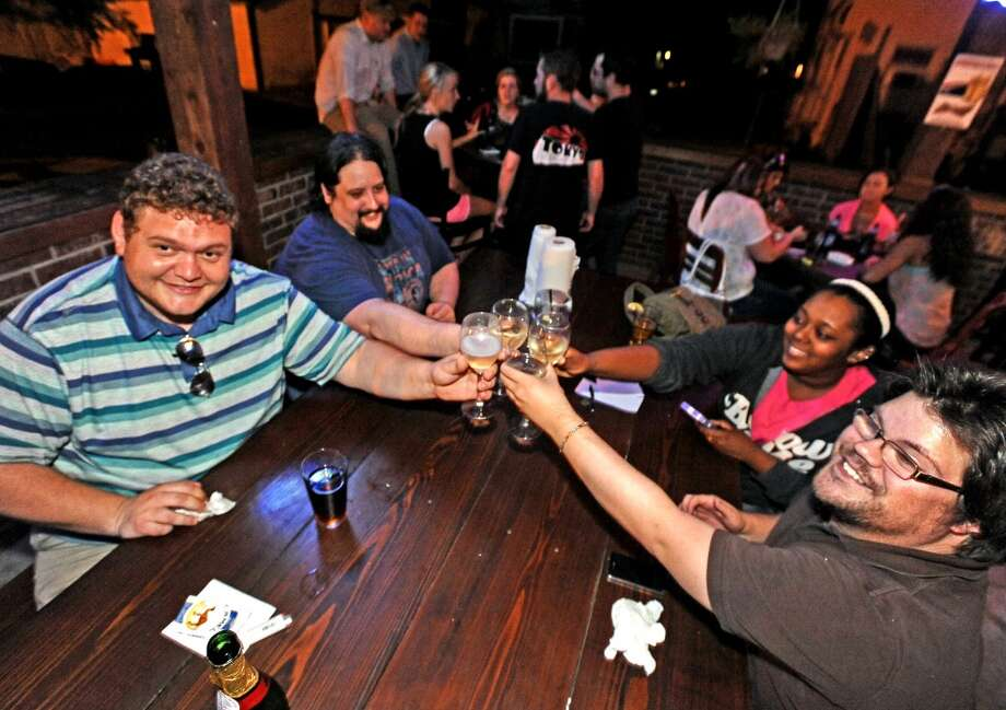 Gandolfini the Grey celebrate a win at Geeks Who Drink trivia game on Tuesday, July 2, 2013, at Luke's. Photo taken: Randy Edwards/The Enterprise