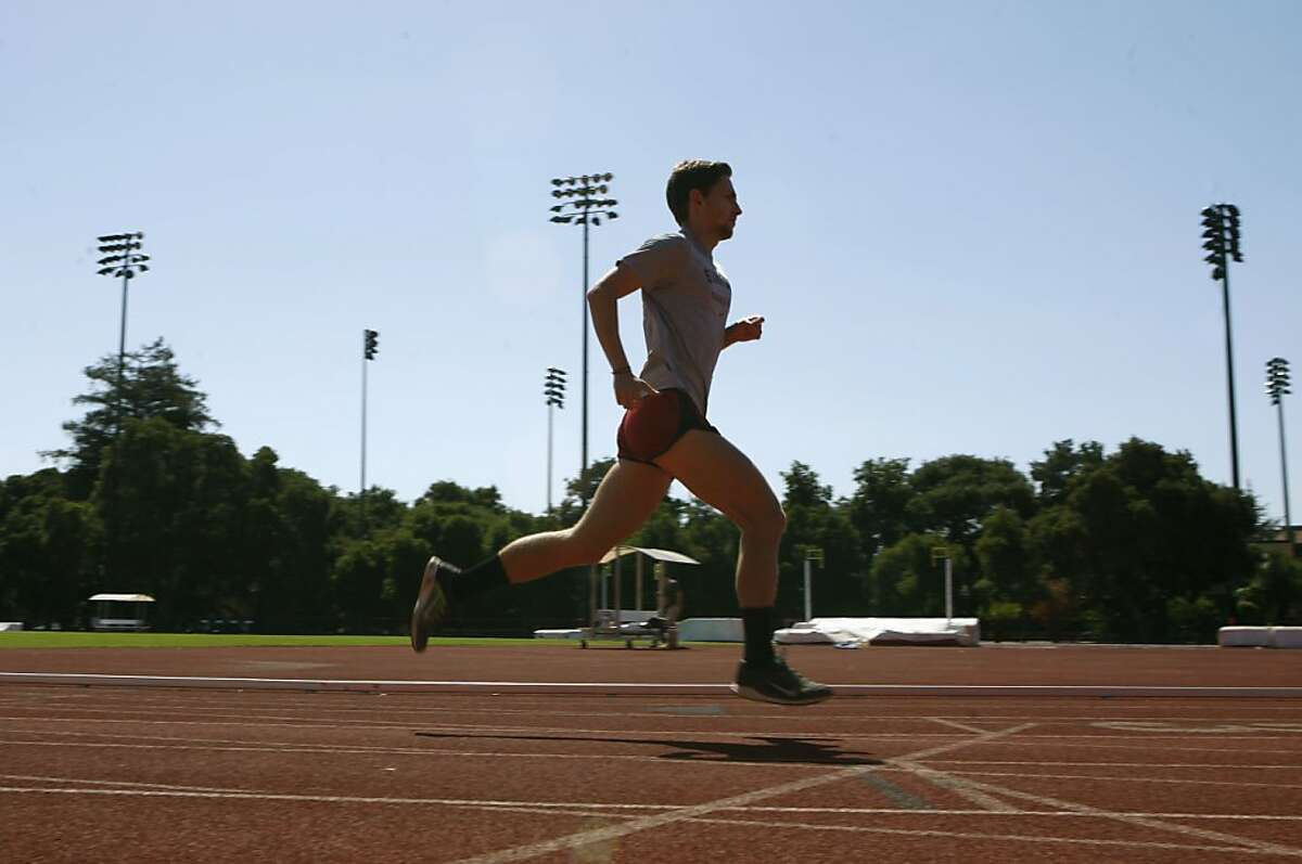 Stanford track member Erik Olson runs on Cobb track at Stanford University in Palo Alto, Calif., on Friday, July 5, 2013. Erik was diagnosed with skin cancer at age 20. Stanford recently launched a program to encourage it's athletes to lather up with sunscreen and practice safe habits when it comes to sun exposure.