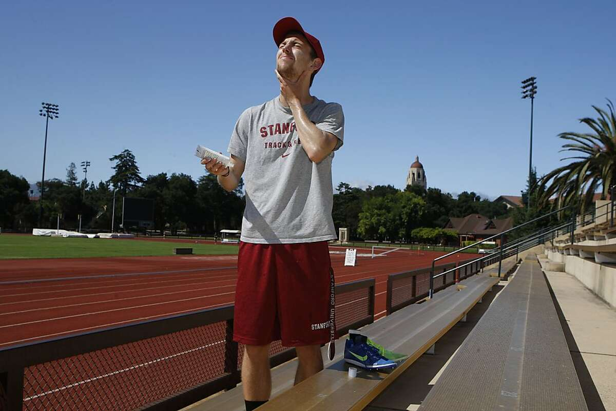 Stanford track member Erik Olson applies sunscreen before running on Cobb track at Stanford University in Palo Alto, Calif., on Friday, July 5, 2013. Erik was diagnosed with skin cancer at age 20. Stanford recently launched a program to encourage it's athletes to lather up with sunscreen and practice safe habits when it comes to sun exposure.