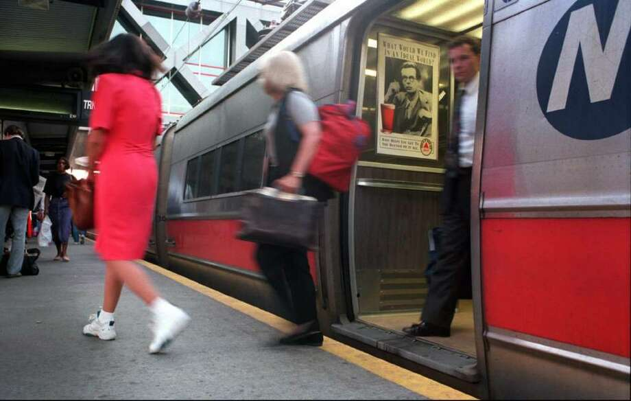 Commuters disembark from a Metro North train at the Stamford Transportaion Center. Photo: File Photo / Stamford Advocate File Photo