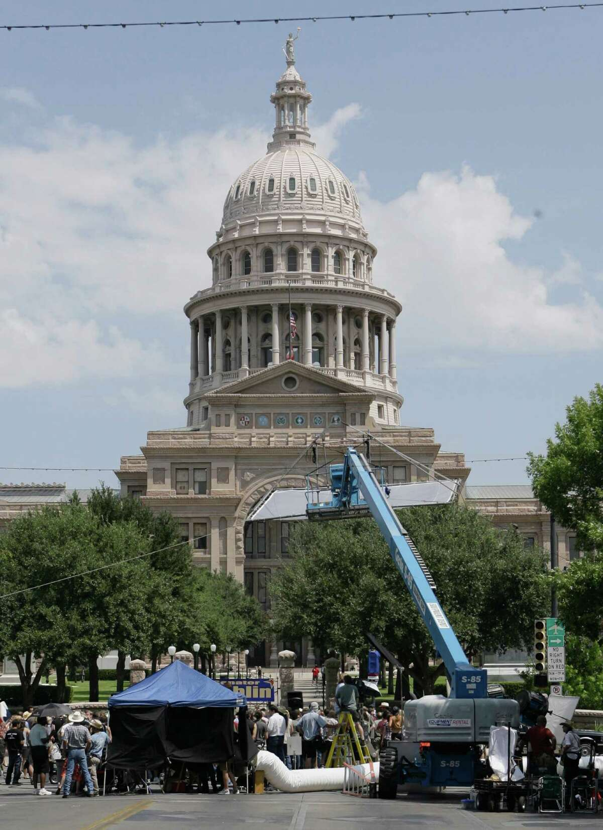 A film crew is shown on location at Congress Avenue near the Texas state Capitol for the Robert Rodriguez action movie