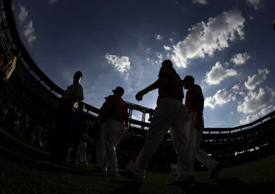 Players walk on the field during batting practice for the MLB All-Star baseball game, on Monday, July 15, 2013 in New York.