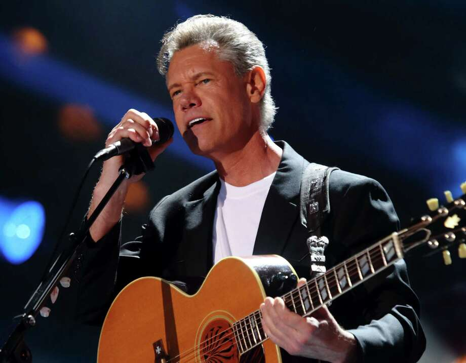 FILE - In this June 7, 2013 file photo, Randy Travis performs at the 2013 CMA Music Festival  in Nashville Tenn. Travis is awake and making progress as he recovers from surgery following a stroke. A news release and video from the Texas hospital where the 54-year-old singer is recovering described Travis' condition Monday, July 15, and doctors gave a new cause for the health troubles _ scarring on his heart. (Photo by John Davisson/Invision/AP, File) Photo: AP