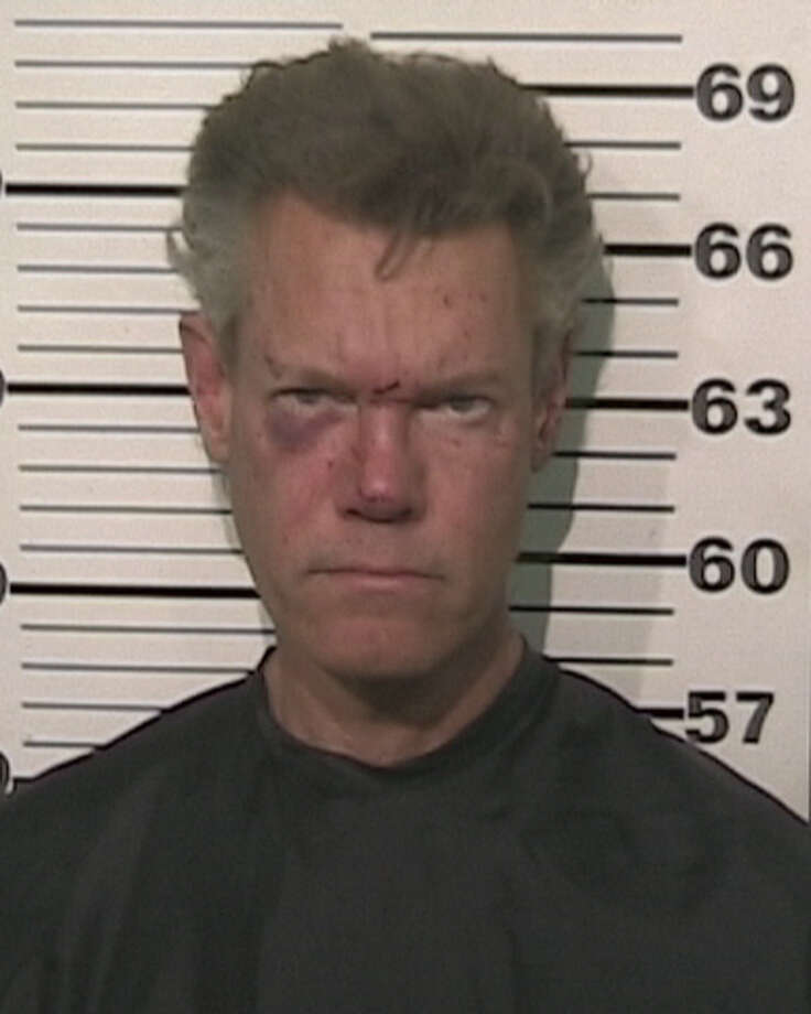 In this handout provided by the Grayson County Sheriff?s Office, musician Randy Travis is seen in a police booking photo August 7, 2012 in Sherman, Texas.  Travis was charged with misdemeanor DWI and felony Retaliation after he was involved in a one vehicle accident.  He was later released on bond. Photo: Handout, Getty Images / 2012 Grayson County Sheriff's Office