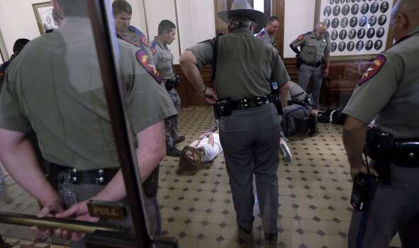 Texas state troopers stand over pro-abortion rights protesters. Photo: Eric Gay, Associated Press