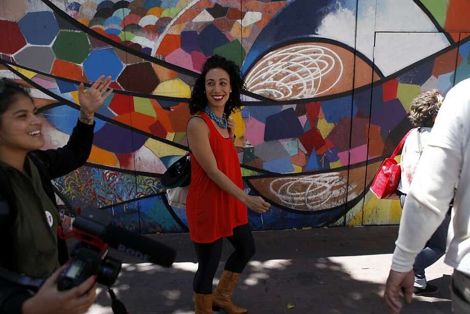 """Top: Bianca Gutiérrez (right, with co-producer Nina Parks) walks down Market Street in a recent episode of """"B Starr TV."""" Photo: Katie Meek, The Chronicle"""