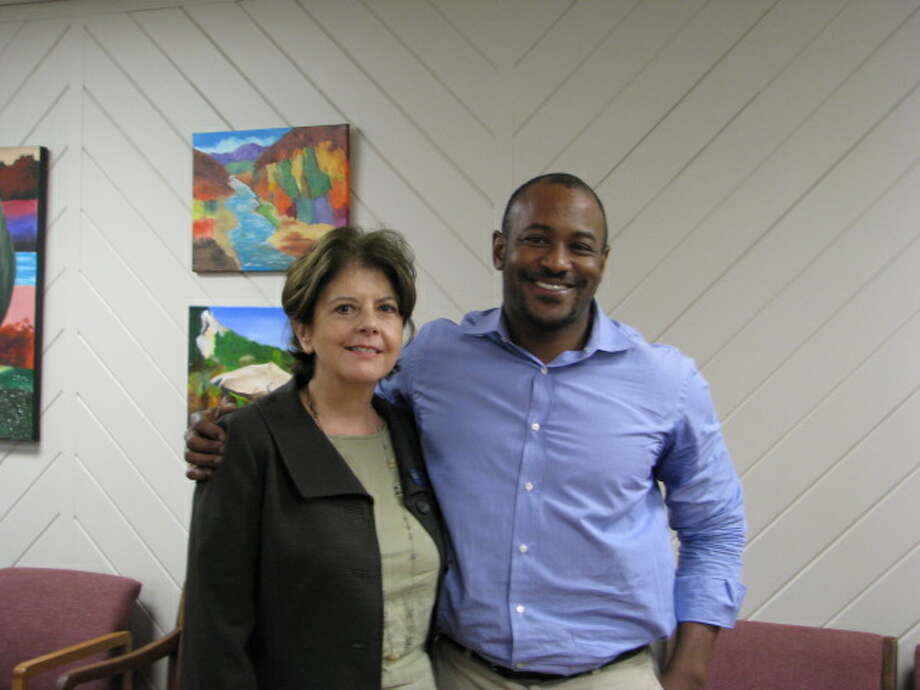 Debra Dyason, left, of Montgomery County United Way, stands with policy analyst Don Baylor Jr., a recent speaker at the charity organization. Photo: Provided By Montgomery County United Way