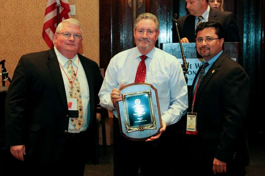 Ron Hickman, center, receives the Best Practices Award from Mike Truitt, left, and Martin Castillo of the Justices of the Peace and Constables Association of Texas on June 25. Photo: Provided By Harris County Constable Precinct 4