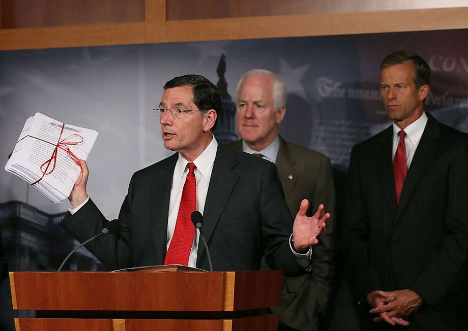 Republicans like Sens. John Barrasso of Wyoming (left) and John Cornyn of Texas (center), speaking about Obamacare in Washington, hope to delay and defund key parts of the Affordable Care Act. Photo: Mark Wilson, Getty Images