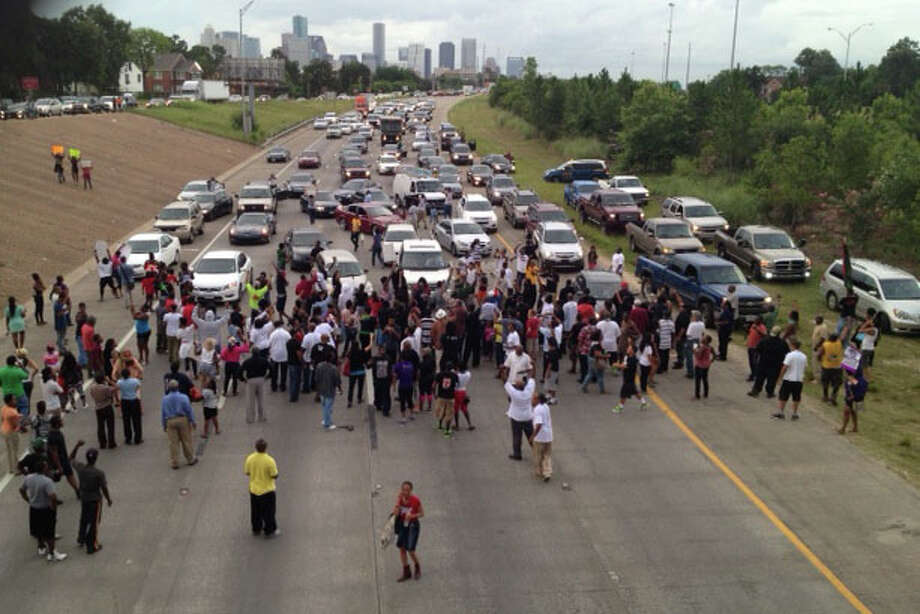 Protesters on  on Texas 288 near Southmore.