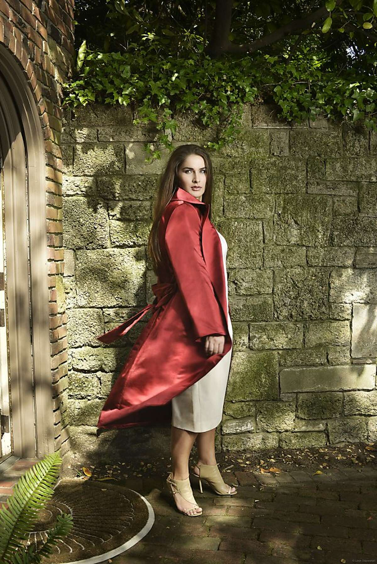 Gabriela Rossetti is a new high-end plus-size fashion line based in San Francisco. Pictured: Catherine coat in claret red over Marion skirt in ivory with the Gabriella Rossetti perfect tee.