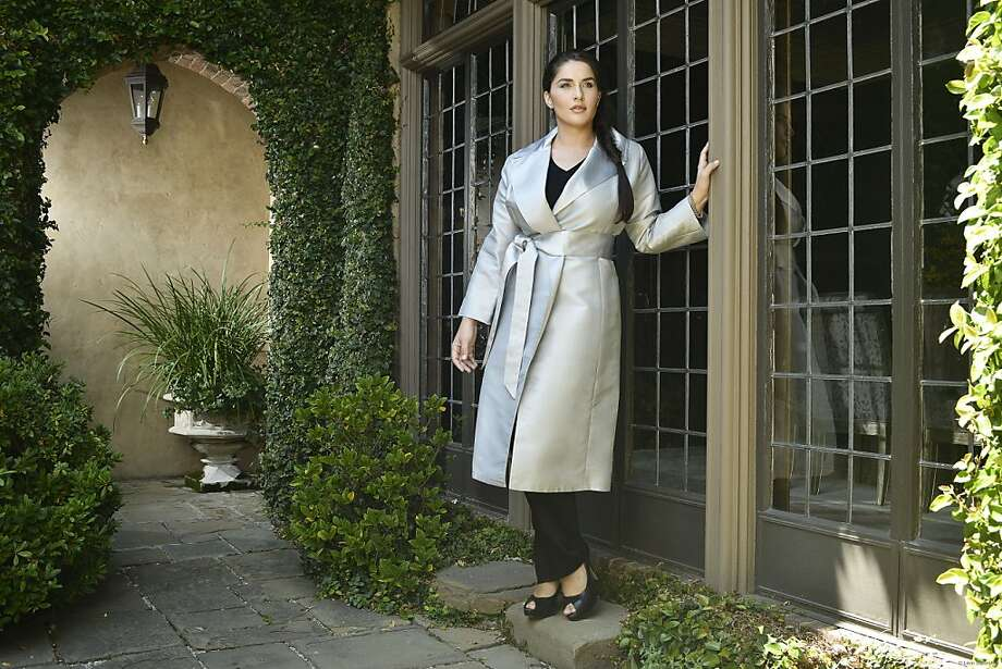 The Catherine coat in gray is from Gabriella Rossetti, a just-launched plus-size fashion line based in San Francisco. On the cover: The Catherine coat in claret red over the Marion skirt in ivory with the Gabriella Rossetti perfect tee. Photo: Leon Saperstein