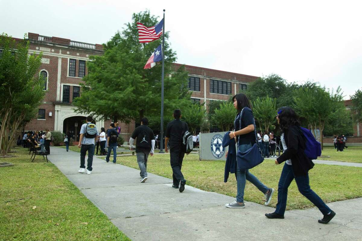 Students arrive to the High School for Law Enforcement and Criminal Justice Wednesday, May 25, 2011, in Houston.