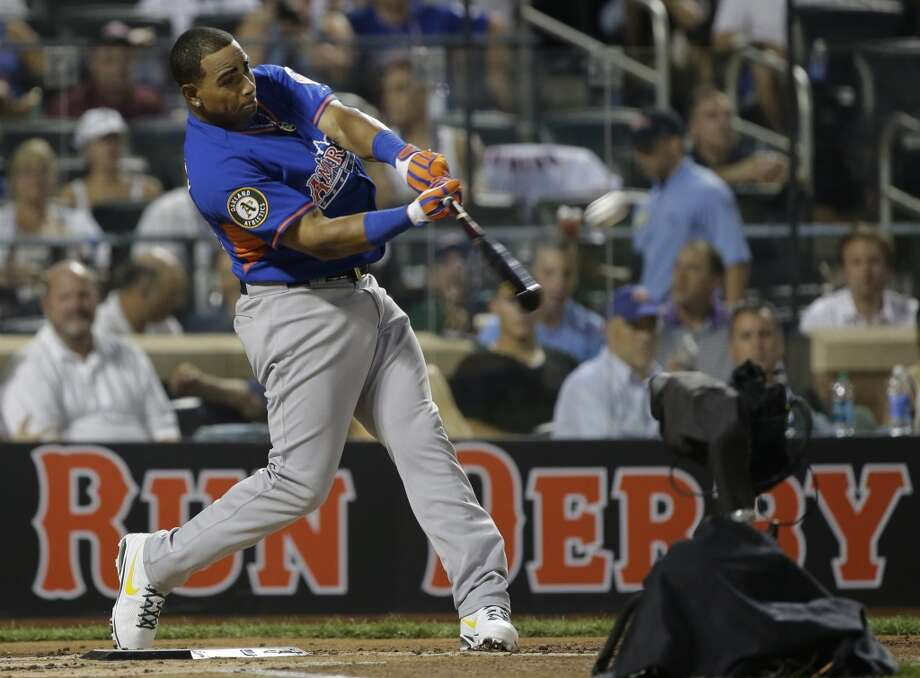A's outfielder Yeonis Cespedes takes a swing during the Home Run Derby.