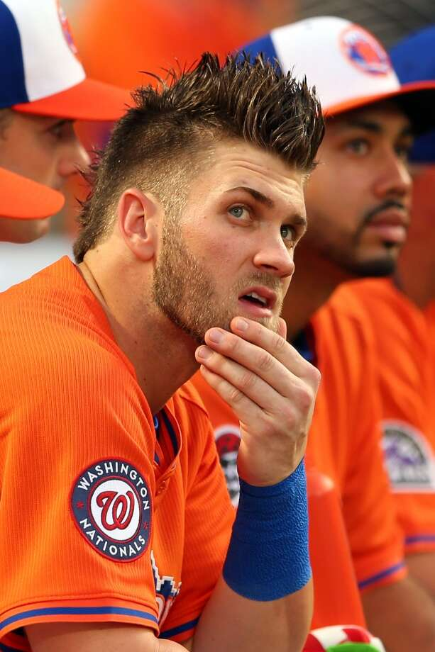 Bryce Harper of the Washington Nationals watches the All-Star festivities.