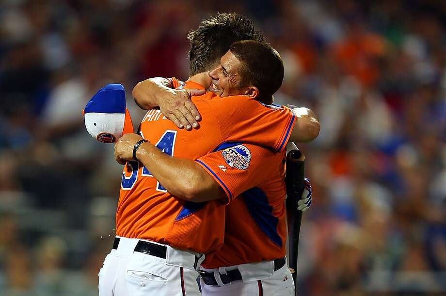 Bryce Harper of the Washington Nationals gets a hug from his father Ron Haper during the Chevrolet Home Run Derby on July 15, 2013 at Citi Field in the Flushing neighborhood of the Queens borough of New York City. Photo: Mike Ehrmann, Getty Images