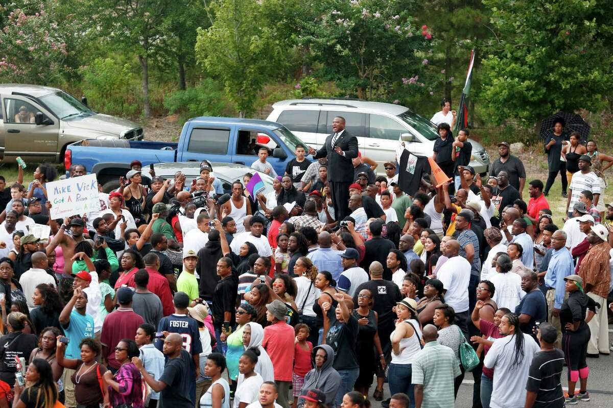 Activist Quanell X, center, led the protest, which began at the Byrd Funeral Home on Wheeler and ended up on Texas 288 at Southmore. Houstonians protestedGeorge Zimmerman's acquittal in the death of unarmed, black Florida teen Trayvon Martin.