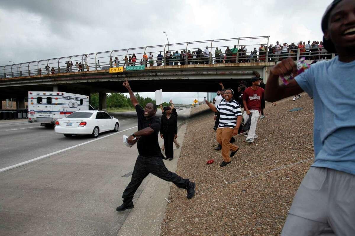A protester on Texas 288