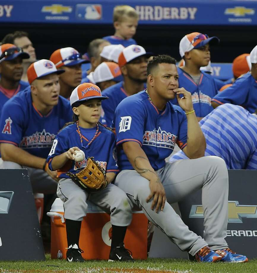 Miguel Cabrera, right, of the Detroit Tigers sits with American League teammates during the MLB All-Star baseball Home Run Derby. Photo: Matt Slocum, Associated Press