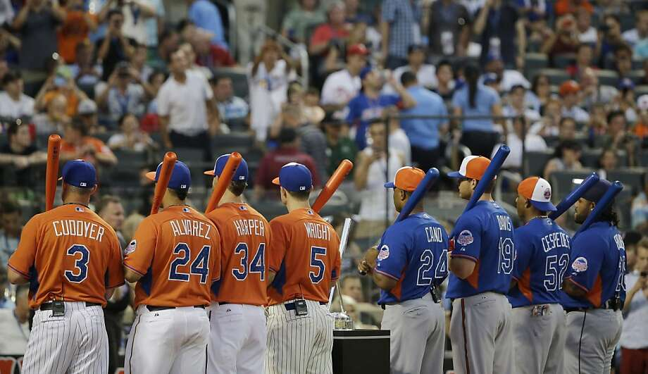 Contestants from the American and National Leagues line up on the field for the MLB All-Star baseball Home Run Derby, on Monday, July 15, 2013 in New York. Photo: Matt Slocum, Associated Press