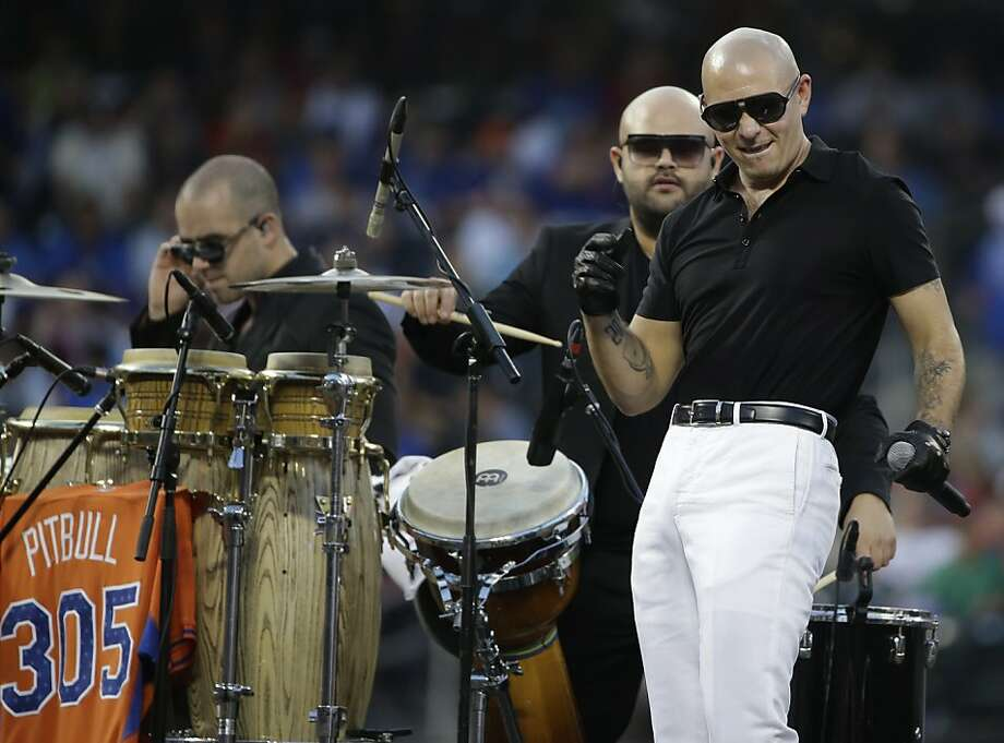 Rapper Pitbull, right, performs before the MLB All-Star baseball Home Run Derby, on Monday, July 15, 2013 in New York. Photo: Kathy Willens, Associated Press