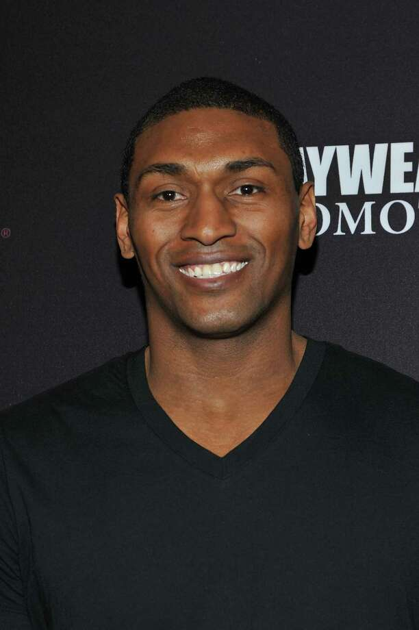 FILE - JULY 15, 2013:  It was reported that Metta World Peace sign a deal with the New York Knicks on a two-year deal after being amnestied by the Los Angeles Lakers July 15, 2013.  LAS VEGAS, NV - MAY 04:  NBA player Metta World Peace arrives at a VIP pre-fight party at the WBC welterweight title fight between Floyd Mayweather Jr. and Robert Guerrero at the MGM Grand Hotel/Casino on May 4, 2013 in Las Vegas, Nevada.  (Photo by Jeff Bottari/Getty Images) ORG XMIT: 152063310 Photo: Jeff Bottari / 2013 Getty Images