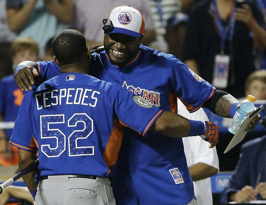 Yoenis Cespedes, left, of the Oakland Athletics, embraces David Ortiz of the Boston Red Sox. Photo: Matt Slocum, Associated Press